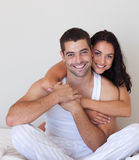 Smiling Romantic Couple. Young smiling romantic couple relaxing in each others Royalty Free Stock Image