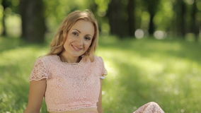 Smiling Romantic Woman Sitting On The Grass stock footage