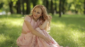 Smiling Romantic Woman Sitting On The Grass stock video