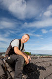 Smiling roofer sitting on the rooftop Royalty Free Stock Photography