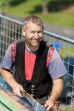 Smiling roofer welding the gutter Stock Photography