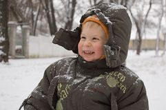 Smiling ruddy-faced little boy Stock Images