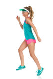 Smiling Runner Woman Jumping Stock Images