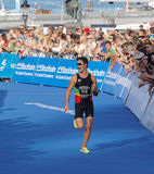 Smiling running triathlete Joao Pereira fighting at the finish Royalty Free Stock Images