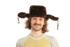 Smiling Russian man in cap with ear-fl Royalty Free Stock Photography