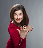 Smiling 30s female comedian waving like at theatre Royalty Free Stock Image