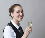 Smiling 20s girl holding glass of bubbly wine at party to celebrate success at becoming sommelier Stock Images