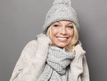 Smiling 20s girl staying warm in wrapping cozy winter scarf Stock Image