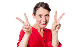 Smiling 30s woman with two v victory signs agreeing Royalty Free Stock Photos