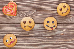 Smiling and sad cookies Stock Images