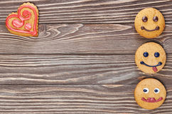 Smiling and sad cookies Stock Image