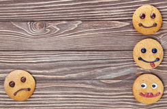 Smiling and sad cookies Royalty Free Stock Photos