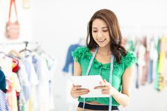 Smiling Sales assistant in clothing store. Young smiling Sales assistant in clothing store royalty free stock photo