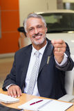 Smiling salesman giving a customer car keys Royalty Free Stock Images