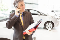 Smiling salesman having a phone call Stock Photos