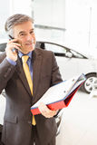 Smiling salesman having a phone call Royalty Free Stock Photography