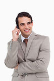 Smiling salesman on his cellphone Royalty Free Stock Photography