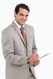 Smiling salesman with notepad and pen Stock Photos