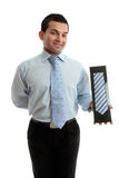 Smiling salesman proudly with merchandise Royalty Free Stock Photography