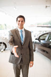 Smiling salesman ready to shake hand Stock Photography
