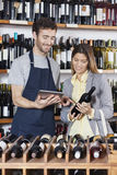 Smiling Salesman Showing Wine Information To Customer On Digital Royalty Free Stock Images