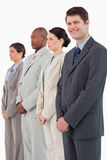 Smiling salesman standing next to his colleagues Royalty Free Stock Photos