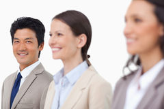 Smiling salesman standing next to smiling colleagues Royalty Free Stock Photo