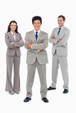 Smiling salesteam with folded arms. Against a white background royalty free stock photos