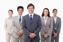 Smiling salesteam standing Stock Photo
