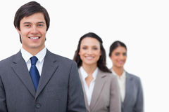 Smiling salesteam standing in line Royalty Free Stock Photo