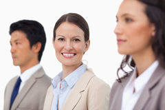 Smiling saleswoman between her colleagues Royalty Free Stock Images