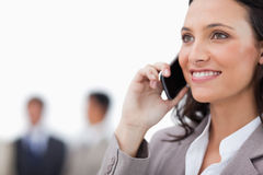 Smiling saleswoman on her phone Stock Photo