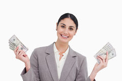 Smiling saleswoman with money in her hands. Against a white background Stock Photos