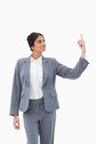 Smiling saleswoman pointing up Royalty Free Stock Photo