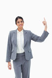 Smiling saleswoman pointing upwards Stock Photography