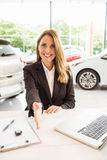 Smiling saleswoman ready to shake hand Stock Image