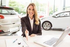 Smiling saleswoman ready to shake hand Royalty Free Stock Photo