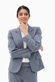 Smiling saleswoman in thinkers pose Royalty Free Stock Photography