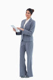 Smiling saleswoman using tablet Royalty Free Stock Photos
