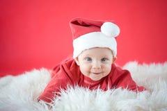 Smiling Santa. Cute baby in Santa costume Stock Photography