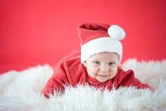 Smiling Santa. Cute baby in Santa hat Stock Photography