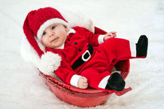 Smiling Santa baby in red bucket Royalty Free Stock Image