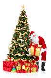 Smiling Santa and Christmas Tree Stock Photography