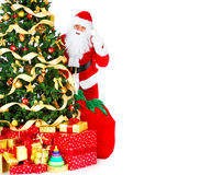 Smiling Santa and Christmas Tree Stock Image