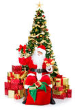 Smiling Santa and Christmas Tree Stock Images