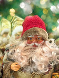 Smiling Santa Claus on a blurred background with bokeh Royalty Free Stock Photos