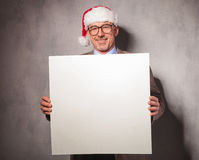 Smiling santa claus business man holding a blank board Royalty Free Stock Photo