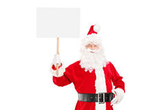 Smiling Santa Claus holding a blank panel. Isolated on white background Stock Images