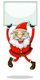 A smiling Santa Claus holding an empty signage Royalty Free Stock Photography