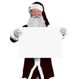 Smiling Santa Claus holding a white board mock up advertisement Stock Photo